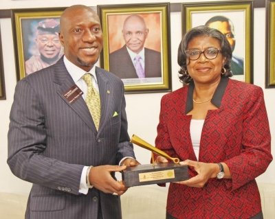 CEO NSE presenting the Gong to the D-G DMO at the listing of the $300 million Diaspora Bond and the $3 billion Eurobonds on The NSE and FMDQ OTC on Thursday, December 21, 2017